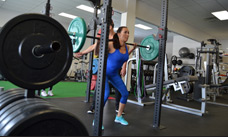woman squatting heavy weight Excellent Fitness Value